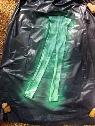Spray painting leggings green for costume