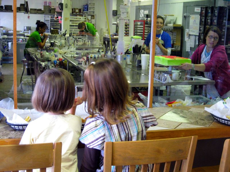 Ricks Bakery Fayetteville watching the cake decorators
