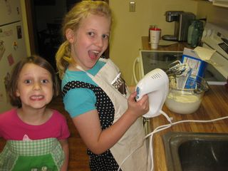Two little cuties whipping up a pie