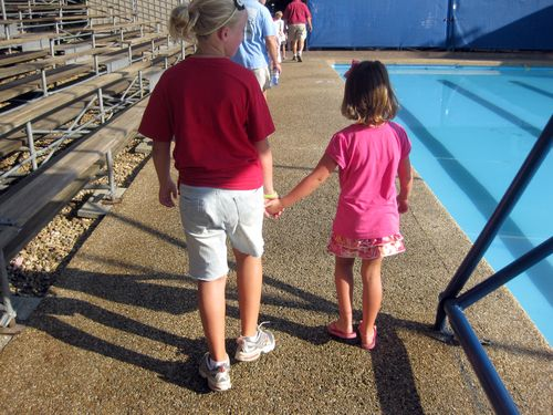 Sisters hand in hand