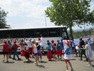Counselors meeting the camper bus