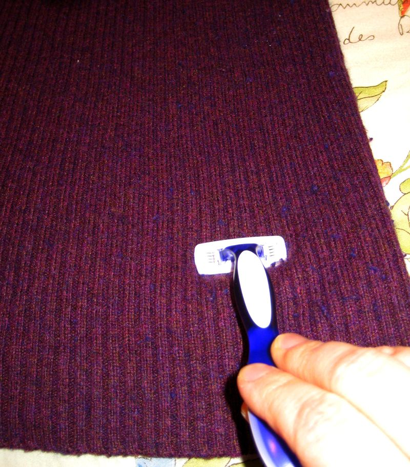 Sweater shave with a razor
