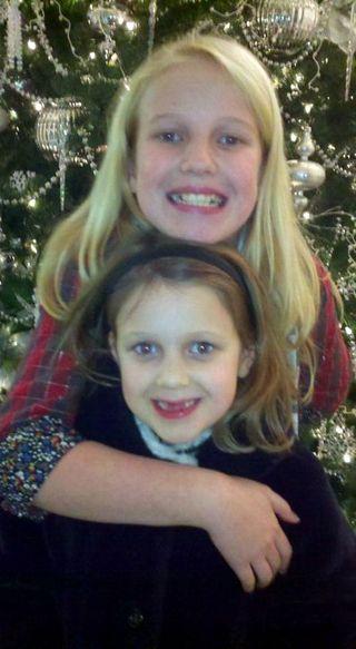 Sweet sisters two front teeth