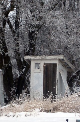 Cold snowy outhouse