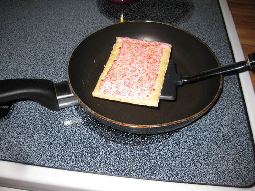 Quick junk food dinner toasting the pop tarts