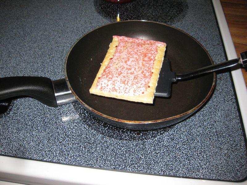 Quick junk food dinner toasting the pop tarts