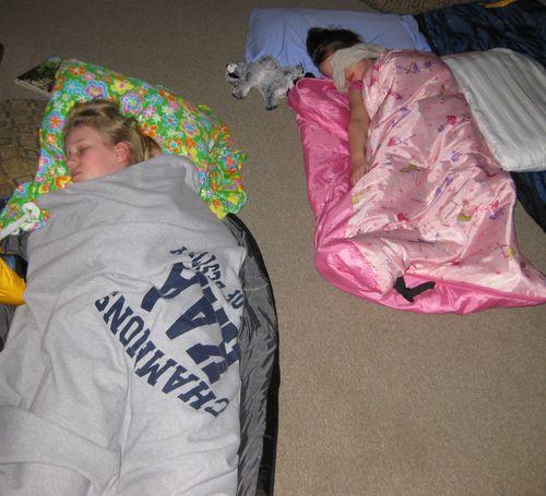 Camping sleeping baby girls