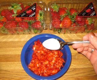 Strawberry cake sugaring the strawberries