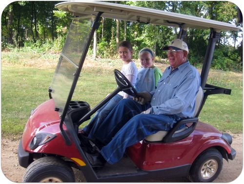 Apple picking golf cart ride with grandpa