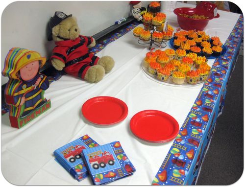 Fireman cupcakes on the party table
