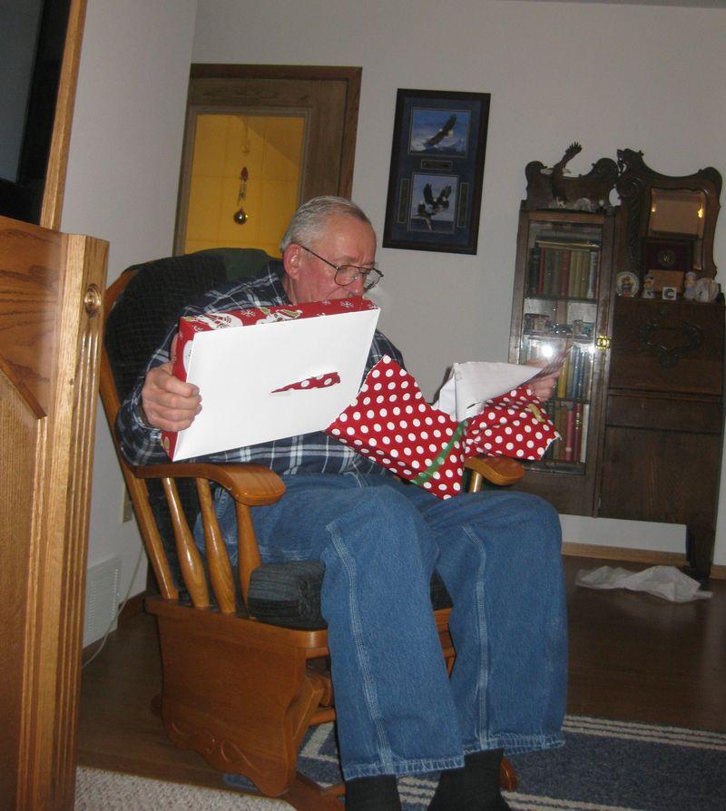 Christmas grandpa opening present
