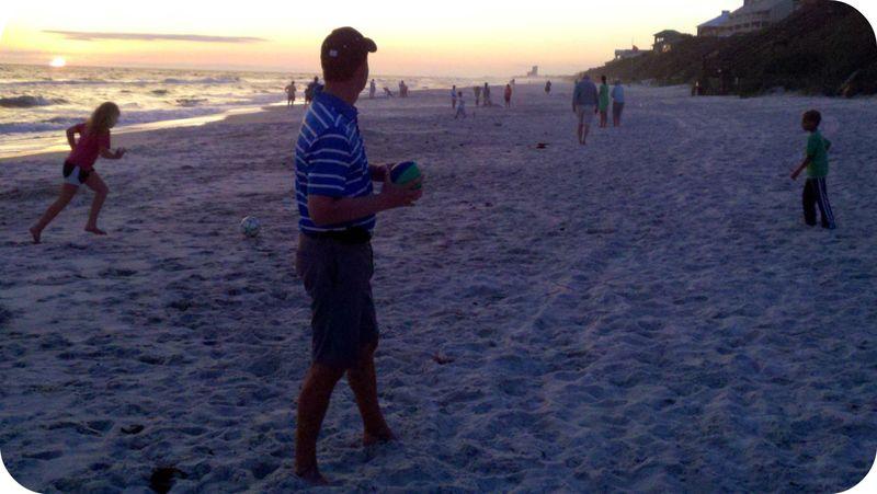 Sunset football on the beach