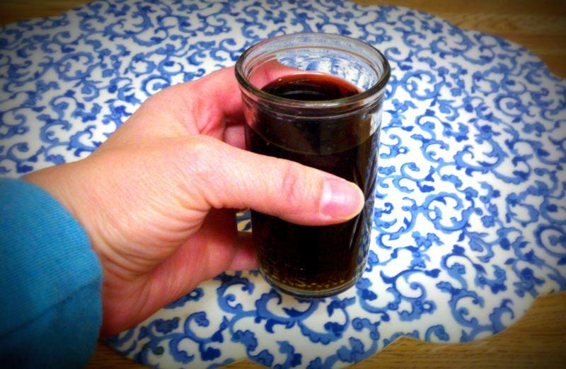 Itty bitty coke in a juice glass