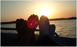 Feet in the sunset on the lake