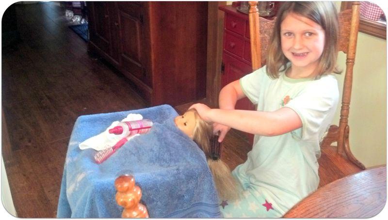 Weekend pics brushing her doll hair